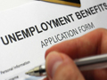 Jobless claims fall to 15-year low, inflation remains muted