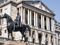 Bank of England says it was in no hurry to raise interest rates